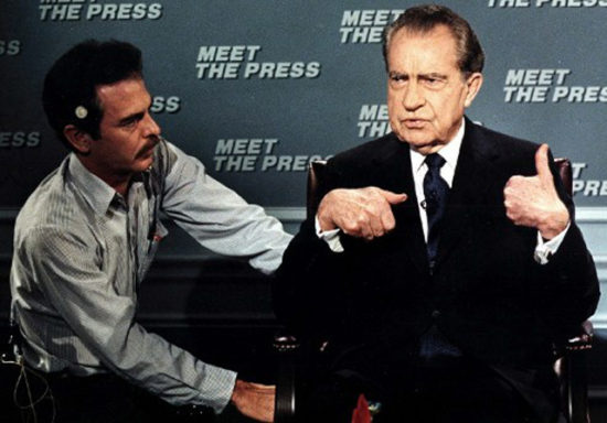 "This file photo shows former US President Richard Nixon(R) as he gestures while being wired for a microphone by an NBC technician 09 April 1988 in Washington,DC before the start of the taping of the television show ""Meet the Press"". It was the first appearance of Nixon on the show since 1968. When Nixon was asked about the current political campaign, he called Jesse Jackson ""a poet"" and Michael Dukakis ""a word processor"". AFP PHOTO/Jerome DELAY / AFP PHOTO / JEROME DELAY"